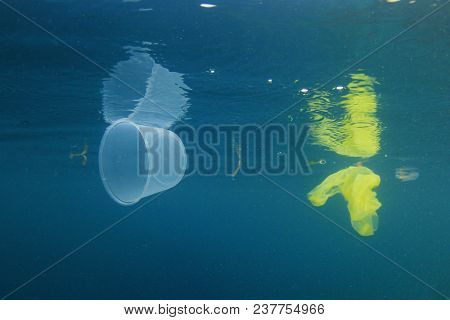 Plastic cups and bags pollution in ocean