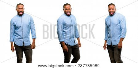 African american man with beard feeling disgusted with tongue out