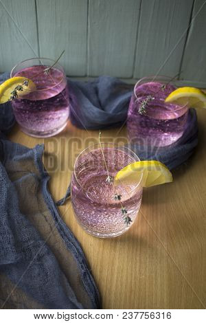 Fresh And Bright Lavender Lemonade On The Kitchen Table With A Tablecloth