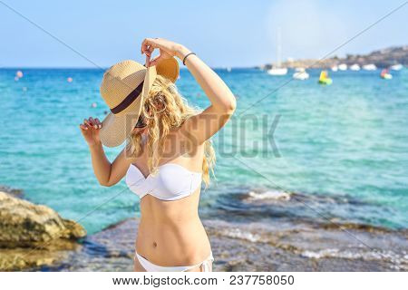 Happy Woman At The Beach In Cyprus. Beautiful Summer Seaside View. Enjoying Sunny Day