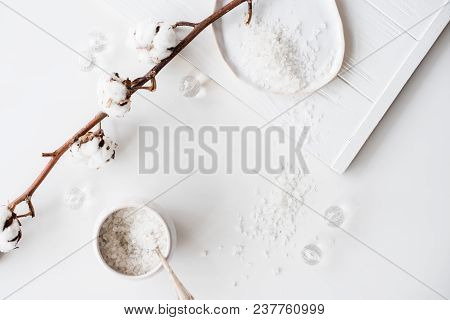 Cosmetic Sea Salt And Cotton Flowers On A White Background, Bath And Care Objects