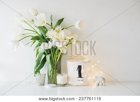 Large Bouquet Of White Spring Flowers In A Vase, Daffodils, Tulips And Feces In Home Interior Decor