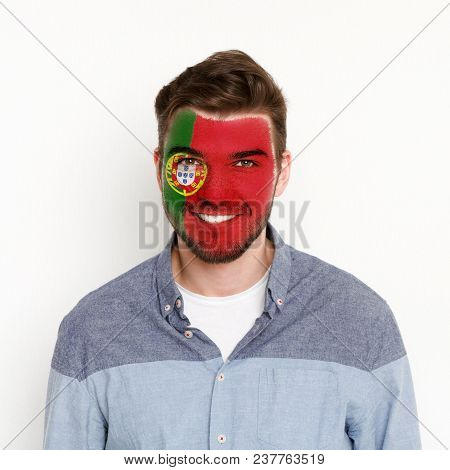 Face Of Young Happy Man Painted With Flag Of Portugal. Football Or Soccer Team Fan, Sport Event, Fac