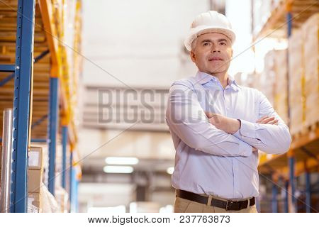 Delivery System. Smart Logistics Manager Wearing A Helmet While Being At Work In The Warehouse