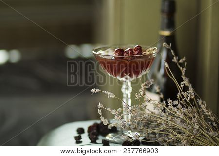 Red Cocktail With Berries Of Cherry And Whiskey
