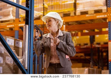 Warehouse Manager. Positive Nice Woman Using A Scanning Device While Working As A Warehouse Manager