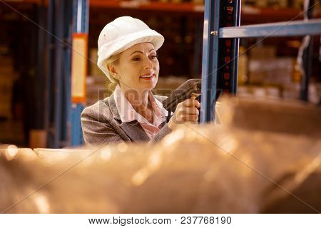 Storehouse Inventory. Joyful Delighted Woman Scanning Goods While Checking The Storehouse Inventory