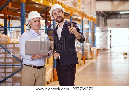 Optimization Of Work. Cheerful Positive Businessman Pointing With His Finger While Explaining His Id