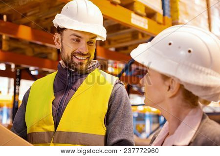 Professional Collaboration. Joyful Positive Man Smiling While Looking At His Female Colleague