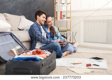 Couple Planning Vacation Trip, Man And Woman Browsing On Laptop, Looking For Interesting Travel, Sit