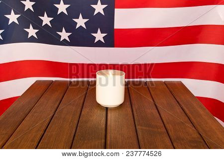 American Flag And Memorial Candle On Veterans Day . On Wooden Background