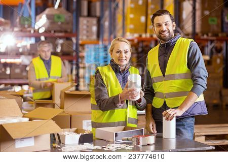 Wholesale Retail. Joyful Positive People Looking At You While Working In The Wholesale Retail Indust