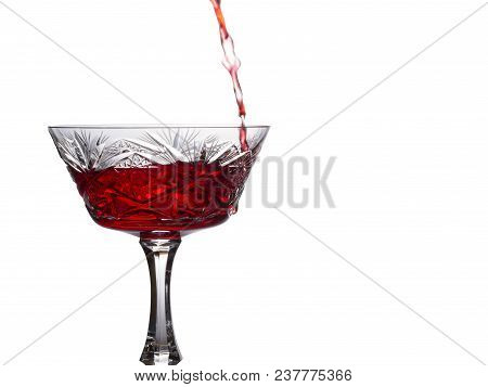 Red Wine Pours Into A Vintage Glass Of Bright And Beautiful On A White Background A Delicious Alcoho