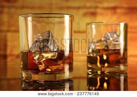 Chilled Two Whiskey Glasses With Ice Cubes