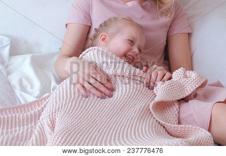 Young Attractive Blond Mom Plays Hide And Seek With Her Little Charming Daughter In Pink Dresses