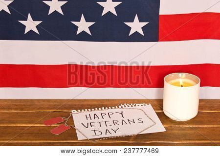 American Flag And Army Tokens On Veterans Day . Memorial Candle . On Wooden Background .