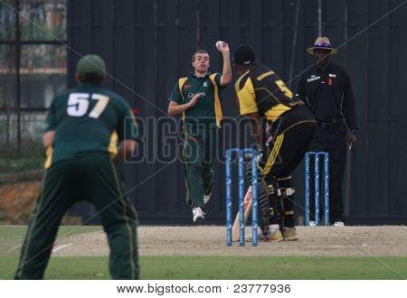 PUCHONG, MALAYSIA - SEPT 24: Rakesh Madhavan (5), Malaysia bats against Guernsey at the Pepsi ICC World Cricket League Div 6 finals at the Kinrara Oval on September 24, 2011 in Puchong, Malaysia.