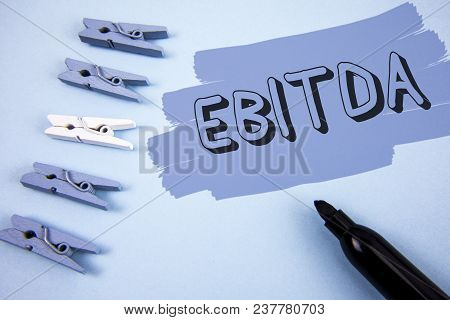 Conceptual Hand Writing Showing Ebitda. Business Photo Text Earnings Before Tax Is Measured To Evalu