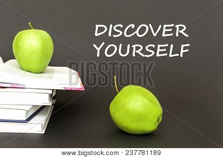Concept Back To School, Text Discover Yourself, Two Green Apples, Open Books On Gray Background