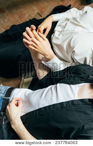 Holding Hands. Lovers Couple Holding Hands In A Room. Hand In Hand.lying On The Floor