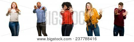 Group of cool people, woman and man disgusted and angry, keeping hands in stop gesture, as a defense, shouting