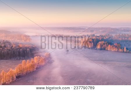 Spring Foggy Aerial Landscape. Aerial Drone View Of Spring Field With Fog. Nature Background.