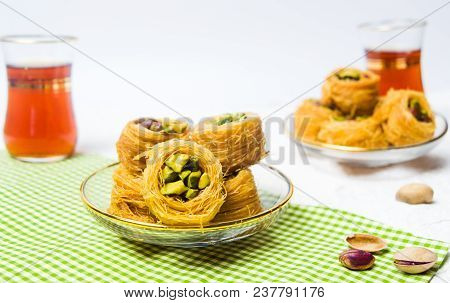Arabic Dessert With Pistachio Mabroume Served With Tea