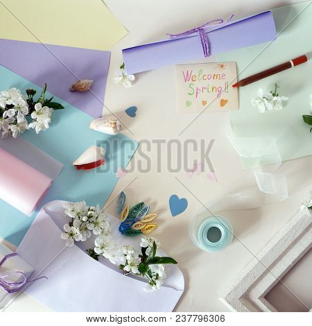 White Envelope With Cherry Flowers, Pencil, Colored Paper And Greeting Card With Spring