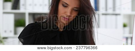Beautiful Smiling Brunette Woman Sit At Table Hold In Arm Papers Portrait Colleagues In Background.