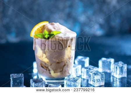 Orange Soda Creamsicle Ice Cream Float In Glass Decorated With Piece Of Orange And Leaves On Mint, S