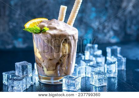 Orange Soda Creamsicle Ice Cream Float In Glass Decorated With Piece Of Orange, Straws And Leaves On