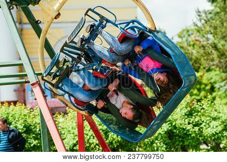 Vichuga, Russia - June 24, 2017: Two Girls Ride A Carousel In The Park On The Day Of Vichuga, Russia