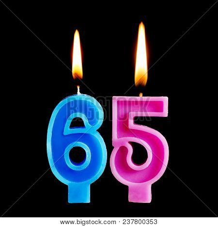 Burning Candles In The Form Of 65 Sixty Ive Figures (numbers, Dates) For Cake Isolated On Black Back