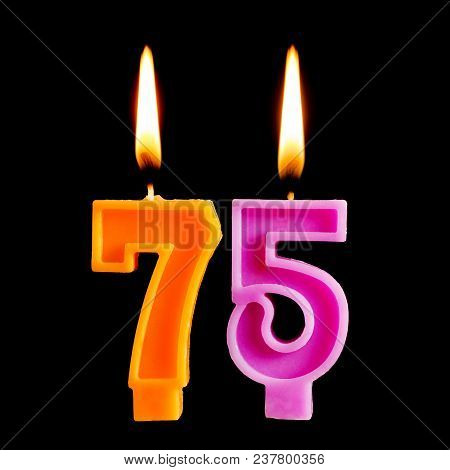 Burning Candles In The Form Of 75 Seventy Five Figures (numbers, Dates) For Cake Isolated On Black B
