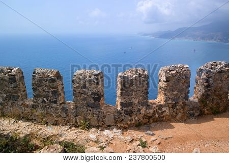 Fragment Of The Fortress Wall Overlooking The Sea. The Top Of The Wall Has Intervals For Shooters. T