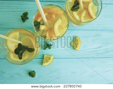 Lemonade With Fresh Lemon And Mint On Blue Wooden