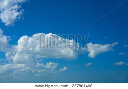Blue sky summer white cumulus clouds background poster