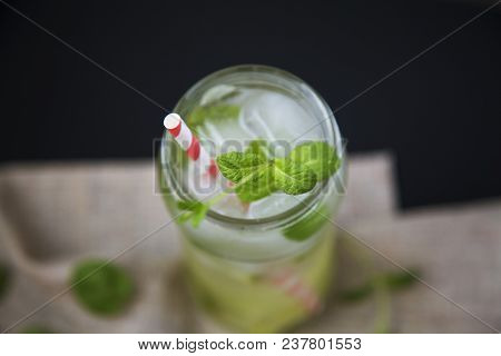 Mojito Cocktail With Ice, Lime And Mint On Dark Background. Top View. Closeup