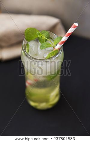Summer Drink With Ice, Fresh Lime And Mint On Dark Background. Side View.