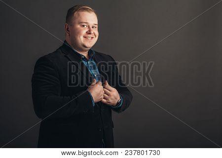 Plus Size Businessman In Black Suit On Black Background