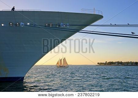 Big Cruise Ship And Small Sailing Boat, Size Comparison, Key West, Florida The Sunshine State, Usa