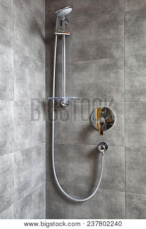 New Shiny Modern Shower In Shower Cabin. Bathroom With Gray Tile.