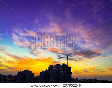 An Amazing Dramatic Cloudy Sunset Over The City And A Beautiful Dramatic Sky With Clouds.