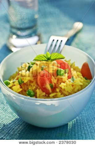 saffron-rice with vegetables mint leaves a garnish poster