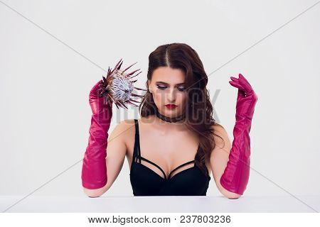 Beautiful Woman Holding Protea Flower In The White Room