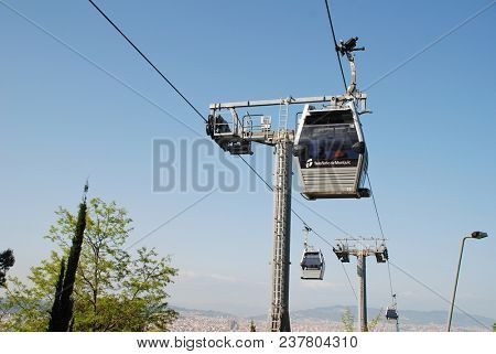 BARCELONA, SPAIN - APRIL 19, 2018: Pods travel on the Teleferic cable car line at Montjuic hill. With 55 cars, the 750 metre route opened in May 2007.