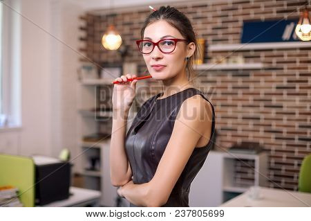 Portrait Of Successful Smiling Business Woman, Worker, Designer, Lady, Female Wearing Glasses And Le