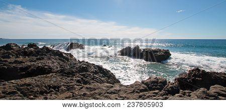 Waves Breaking On Rocky Coastline At Cerritos Beach Between Todos Santos And Cabo San Lucas In Baja