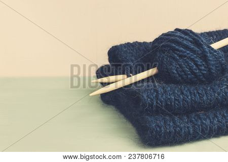 Knitted From Blue Yarn Sweater And Thread For Knitting Closeup. Knitting As A Hobby. Accessories For