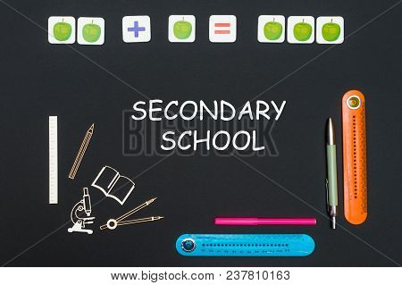 Concept Back To School, Above Stationery Supplies And Text Secondary School On Black Backboard